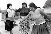 Hungary. Baranya county. Al Soszenmarton is a gypsie village. Three women talk together in the street. A few pupils from Gandhi High School come from the village. The purpose of the middle school / high school is to provide a school-leaving exam (A-level), also to improve the prospects of Romani children in Hungary and to help preserving the Romani culture. The Romani people, also known as the Roma, are an Indo-Aryan people group, traditionally nomadic itinerants living mostly in Europe. The Romani people are widely known in English by the exonym Gypsies (or Gipsies), which is considered by many Romani people to be pejorative due to its connotations of illegality and irregularity as well as its historical use as a racial slur. In many other languages, they are called Roms (Rroms), Tziganes,Tsiganes, Gitans, Bohémiens, Manouches, Romanichels, gitano, zingaro and cigano. 13.05.95 © 1995 Didier Ruef