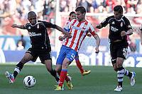 Atletico de Madrid's Gabi Fernandez (c) and Granada's Yacine Brahimi (l) and Nolito during La Liga match.April 14,2013. (ALTERPHOTOS/Acero)