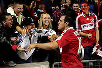 Chicago Fire midfielder Cuauhtemoc Blanco (10) celebrates with the fans after scoring the Fire's second goal late in the second half.  The Chicago Fire defeated the New England Revolution 2-0 to win their playoff series at Toyota Park in Bridegview, IL on November 7, 2009.