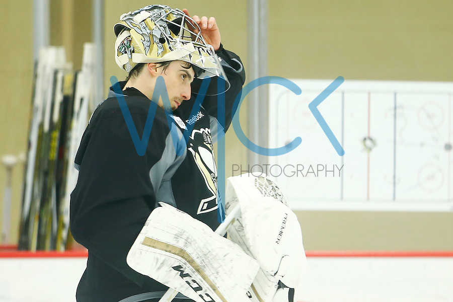Marc-Andre Fleury #29 of the Pittsburgh Penguins puts on his mask during practice at UPMC Lemieux Sports Complex in Cranberry Township, Pennsylvania on April 26, 2016. (Photo by Jared Wickerham / DKPS)