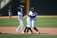 Inland Empire 66ers Leonardo Rivas (3) celebrates with Kevin Williams, Jr. (20) and Orlando Martinez (13) after hitting a walk-off double during a California League game against the Modesto Nuts on April 10, 2019 at San Manuel Stadium in San Bernardino, California. Inland Empire defeated Modesto 5-4 in 13 innings. (Zachary Lucy/Four Seam Images)