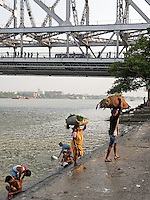 On the Banks of the Hugli/Hooghly River an arm of the Ganges in Kolkata near the Howrah Bridge at Calcutta (Kolkata) in West Bengal in India.