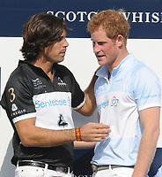 GREENWICH, CT - MAY 15: HRH Prince Harry of Wales_Nacho Figueras at the Sentebale Royal Salute Polo Cup at The Greenwich Polo Club on Wednesday 15th May. The Sentebale Land Rover team was captained by Royal Salute Ambassador Malcom Borwick with team members Mark Ganzi, Michael Carrazza and Prince Harry, one of the founding Patrons of Sentebale. The St. Regis polo team was captained by Sentebale's Ambassador Nacho Figueras with team members Peter Orthwein, Steve Lefkowitz and Dawn Jones. Royal Salute played host to a number of high profile celebrities. Royal Salute World Polo is a global programme, which now supports tournaments across four continents. The luxury Scotch's involvement with Polo is founded on the game's incredible power, skill and elegance; qualities which blend perfectly with Royal Salute Scotch Whisky, at Greenwich Polo Club on May 15, 2013 in Greenwich, Connecticut<br /> <br /> People:  HRH Prince Harry of Wales_Nacho Figueras