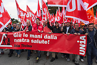 Switzerland. Canton Ticino. Bellinzona. The wave of national protest in the construction industry began on October 15 in Ticino. 3000 masons from Ticino interrupted their work to meet in Bellinzona and demand that retirement be maintained at 60. In addition to retirement at 60, the fight against wage dumping and longer working hours are at the heart of the demands. Unia and OCST unions said in a joint statement that masons have had enough after a year of blocking negotiations and blackmail. The workers and their unions have therefore decided to start a national protest. If no agreements are found between workers and constructions companies, a strike might occur in the near future. 15.10.2018 © 2018 Didier Ruef