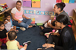 Education Preschool Phase-in First Days of School Early Learn Head Start 2s program circle time with teachers and children welcome song