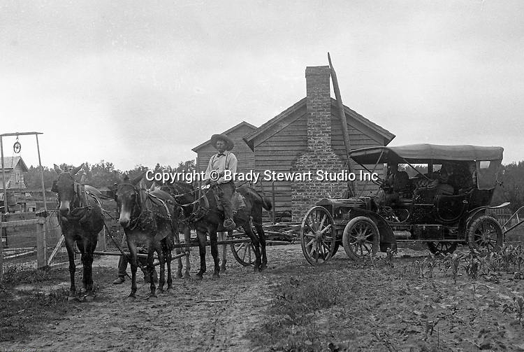 Product:  Brady Stewart Horse-drawn Car Towing Service<br /> <br /> Greensburg PA: Man with 4-horse team towing Brady Stewart's broken down car back to the farm for repairs - 1906