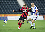 Kilmarnock v St Johnstone...06.12.14   SPFL<br /> Jamie Hamill fends off Chris Millar<br /> Picture by Graeme Hart.<br /> Copyright Perthshire Picture Agency<br /> Tel: 01738 623350  Mobile: 07990 594431