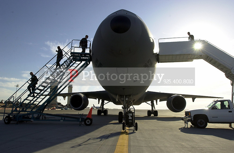 Crew members from the 60th Air Refueling Squadron at Travis Air Force base prepare their KC-10 air tanker prior to a training flight  over California Friday Oct. 5 2001. The KC-10 tankers can transfer up to 340,000 pounds of fuel on a mission. (Photo by Alan Greth)