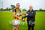 Abbeydorney captain Brian O'Donavan accepts the Div 3 Co League cup from Ger McCarthy of the Kerry Co Comm after their win over Crotta.