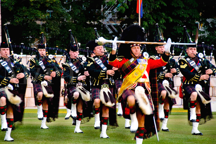 Pipes & Drums band called the Royal Scots Dragoon Guards performing at the Highland Tatoo games in quaint town of Inverness Scotland in the Highlands home of the Loch Ness Monster