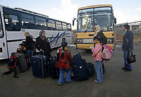 """Palestinian families wait with their luggage to cross the Erez checkpoint from the northern Gaza Strip, 02 December 2007, into Israel on their way to Egypt. Israel today allowed more than 250 Palestinians from the Hamas-run Gaza Strip to cross into Egypt via Israeli territory for the first time in months, witnesses and officials said.  """"photo by Fady Adwan"""""""