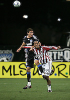 Aaron Pitchkolan (27) and Eduardo Lillingston (99) on the header. Chivas USA defeated San Jose Earthquakes 1-0 at Buck Shaw Stadium in Santa Clara, California on May 2, 2009.