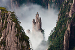 Huangshan pines (Pinus hwangshanensis) on granite spires, Huangshan Mountains, Anhui Province, China<br /> Huang Shan, which means Yellow Mountain and is located in eastern China's Anhui Province, is famous for its countless jagged rock towers, beautiful wind sculpted pine trees, and seas of swirling clouds. <br /> Canon EOS-1Ds Mark III, EF70-200mm f/2.8L IS USM lens +1.4x, f/14 for 1/15 second, ISO 100<br /> <br /> For stock licensing:<br /> http://www.gettyimages.com/detail/photo/huang-shan-anhui-province-china-royalty-free-image/160869668