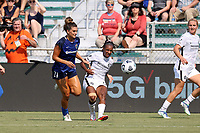 CARY, NC - SEPTEMBER 12: Crystal Dunn #19 of the Portland Thorns FC passes the ball past Cari Roccaro #21 of the North Carolina Courage during a game between Portland Thorns FC and North Carolina Courage at Sahlen's Stadium at WakeMed Soccer Park on September 12, 2021 in Cary, North Carolina.