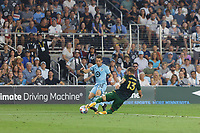 ST PAUL, MN - JULY 24: Ethan Finlay #13 of Minnesota United FC and Dario Zuparic #13 of the Portland Timbers battle for the ball during a game between Portland Timbers and Minnesota United FC at Allianz Field on July 24, 2021 in St Paul, Minnesota.