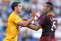 ROME, Italy - September 1, 2013: Roma beats Verona 3-0 during the Serie A match in Olimpico Stadium. In a photo a discussion after a hard foul by Juanito Gomez