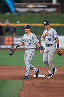 West Michigan Whitecaps left fielder Garrett McCain (10) and shortstop Colby Bortles (30) after the final out of a game against the Quad Cities River Bandits on July 22, 2018 at Modern Woodmen Park in Davenport, Iowa.  West Michigan defeated Quad Cities 6-4.  (Mike Janes/Four Seam Images)