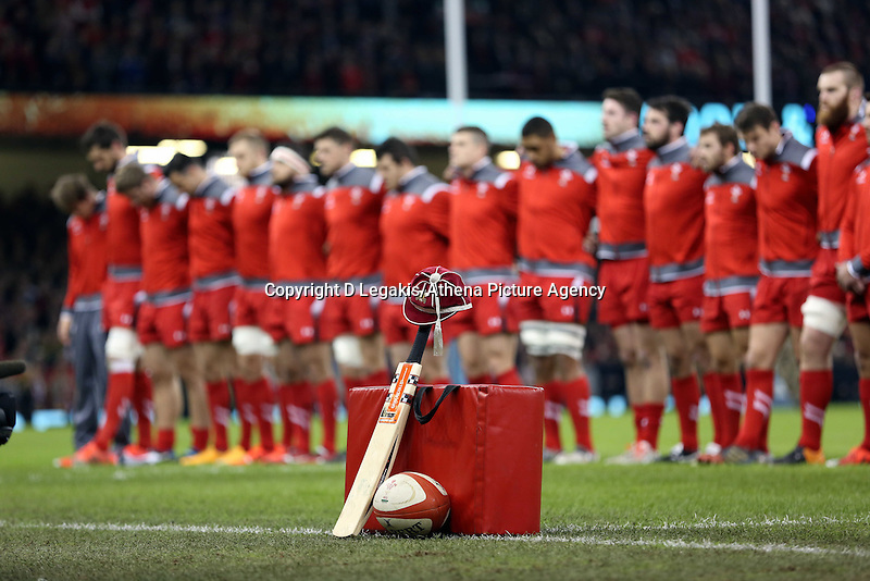 Pictured: Wales rugby players stand during a minute's silence in tribute to the tragic death of cricket player Phillip Hughes. Saturday 29 November 2014<br /> Re: Dove Men Series 2014 rugby, Wales v South Africa at the Millennium Stadium, Cardiff, south Wales, UK.