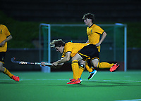 Action from the boys' premier one Wellington Hockey match between Wellington College and Hutt International Boys' High School at National Hockey Stadium in Wellington, New Zealand on Friday, 28 May 2021. Photo: Dave Lintott / lintottphoto.co.nz