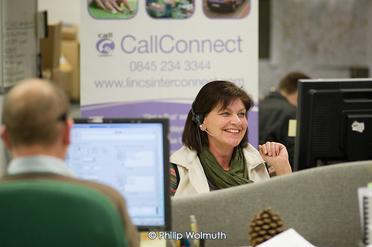 """A journey book agent at the CallConnect transport hub, Lincoln.  The innovative bus-on-demand service features in the Rural Media Company's """"Over the Hill?"""" project."""