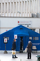 """San Giovanni Addolorata Hospital. <br /> <br /> Rome, 12/03/2020. Documenting Rome under the Italian Government lockdown for the Outbreak of the Coronavirus (SARS-CoV-2 - COVID-19) in Italy. On the evening of the 11 March 2020, the Italian Prime Minister, Giuseppe Conte, signed the March 11th Decree Law """"Step 4 Consolidation of 1 single Protection Zone for the entire national territory"""" (1.). The further urgent measures were taken """"in order to counter and contain the spread of the COVID-19 virus"""" on the same day when the WHO (World Health Organization, OMS in Italian) declared the coronavirus COVID-19 as a pandemic (2.).<br /> ISTAT (Italian Institute of Statistics) estimates that in Italy there are 50,724 homeless people. In Rome, around 20,000 people in fragile condition have asked for support. Moreover, there are 40,000 people who live in a state of housing emergency in Rome's municipality.<br /> March 11th Decree Law (1.): «[…] Retail commercial activities are suspended, with the exception of the food and basic necessities activities […] Newsagents, tobacconists, pharmacies and parapharmacies remain open. In any case, the interpersonal safety distance of one meter must be guaranteed. The activities of catering services (including bars, pubs, restaurants, ice cream shops, patisseries) are suspended […] Banking, financial and insurance services as well as the agricultural, livestock and agri-food processing sector, including the supply chains that supply goods and services, are guaranteed, […] The President of the Region can arrange the programming of the service provided by local public transport companies […]».<br /> Updates: on the 12.03.20 (6:00PM) in Italy there 14.955 positive cases; 1,439 patients have recovered; 1,266 died.<br /> <br /> Footnotes & Links:<br /> Info about COVID-19 in Italy: http://bit.do/fzRVu (ITA) - http://bit.do/fzRV5 (ENG)<br /> 1. March 11th Decree Law http://bit.do/fzREX (ITA) - http://bit.do/fzRFz (ENG)<br /> 2. http://bit.do/fzRKm"""