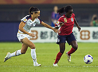 USA defender (15) Kate Markgraf tracks down England forward (9) Eniola Aluko. The United States (USA) defeated England (ENG) 3-0 during a quarter-final match of the FIFA Women's World Cup China 2007 at Tianjin Olympics Center Stadium in Tianjin, China, on September 22, 2007.