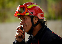 : A Madrid Community firefighter speaks on the radio in San Agustin de Guadalix during a forest fire near Madrid, on August 11, 2012. Wildfires raged Saturday in Spain's Canary Islands and in mainland Galicia, as hundreds fought a blaze near Mount Athos in Greece, a UN Heritage Site housing the world's oldest monastic community. (c) Pedro ARMESTRE
