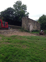 BNPS.co.uk (01202 558833)<br /> Pic: BNPS<br /> <br /> The land before the home was built<br /> <br /> A resourceful couple have made a £150,000 profit after knocking down a derelict old farm building and constructing an impressive eco-friendly retreat in its place.<br /> <br /> Art technician Danielle Coates, 33, and her husband Ben, 33, a carpenter, have created The Rookery, in the scenic village of Roughlee, East Lancs.<br /> <br /> They spent £200,000 buying six acres of farmland and building the two bedroom detached stone home. It has been a shrewd investment as the property, which was completed in 2015, is now valued at £350,000.<br /> <br /> They are currently renting out the two bedroom cottage as a holiday let on cottages.com, with it generating an annual turnover of £50,000.<br /> <br /> Original stones from the demolished farm building have been incorporated into the new structure. Solar panels have been fitted to generate enough energy to run the entire house, and recycled timber from the farm used to fashion shelves and handles.