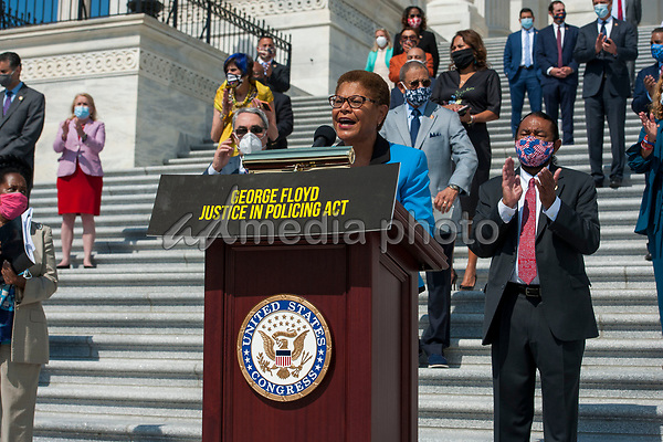 Congressional Black Caucus Chair and United States Representative Karen Bass (Democrat of California) offers remarks while she is joined by other members of Congress on the House steps of the US Capitol, for a press conference ahead of the vote on the George Floyd Justice in Policing Act of 2020 in Washington, DC., Thursday, June 25, 2020. <br /> Credit: Rod Lamkey / CNP/AdMedia