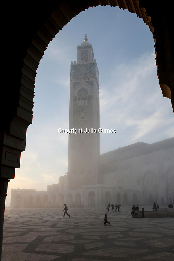 "The Hassan II Mosque rises up through the fog in Casablanca, Morocco.  Referred to as the ""Grand Mosque"", it is the largest mosque in the country and the 7th largest mosque in the world."