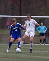 Boston College forward Brooke Knowlton (16) controls the ball as Hofstra University defender Amy Turner (4) pressures. Boston College defeated Hofstra University, 3-1, in second round NCAA tournament match at Newton Soccer Field, Newton, MA.