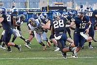 Pitt quarterback Tino Sunseri (12) hands the ball off to Dion Lewis (28). The WVU Mountaineers defeated the Pitt Panthers 35-10 at Heinz Field, Pittsburgh, Pennsylvania on November 26, 2010.