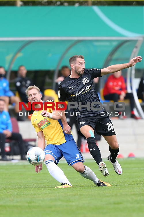 12.09.2020, JODA Sportpark, Todesfelde, GER, DFB-Pokal Runde1 SV Todesfelde vs. VfL Osnabrueck <br /> <br /> DFB REGULATIONS PROHIBIT ANY USE OF PHOTOGRAPHS AS IMAGE SEQUENCES AND/OR QUASI-VIDEO.<br /> <br /> im Bild / picture shows<br /> Christian Rave (SV Todesfelde) im Zweikampf gegen Marc Heider (VfL Osnabrueck)<br /> <br /> <br /> <br /> Foto © nordphoto / Tauchnitz