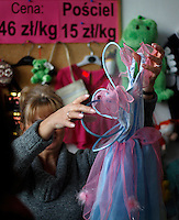 "Ubranie dla dziecka w sklepie z uzywana odzieza popularnie zwanym ""Lumpeks""...Warszawa, 12/2008..Fot: Piotr Malecki....Used clothes at the second hand clothes shop December, 2008 in Warsaw, Poland..Second hand clothes become fashionable among younger generation of Poles who, even if they can afford new clothes, like to search for something less usual. Older people rather come to such shops because of low pension. ..Every two weeks there is a full change of stock and a crowd storms the shop in the first morning.....(Photo by Piotr Malecki)"