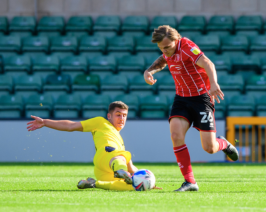 Lincoln City's Harry Anderson is tackled by Oxford United's Cameron Brannagan<br /> <br /> Photographer Chris Vaughan/CameraSport<br /> <br /> The EFL Sky Bet League One - Saturday 12th September 2020 - Lincoln City v Oxford United - LNER Stadium - Lincoln<br /> <br /> World Copyright © 2020 CameraSport. All rights reserved. 43 Linden Ave. Countesthorpe. Leicester. England. LE8 5PG - Tel: +44 (0) 116 277 4147 - admin@camerasport.com - www.camerasport.com - Lincoln City v Oxford United
