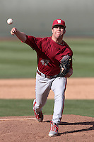 Kellen Camus #47 of the Washington State Cougars pitches against the UCLA Bruins at Jackie Robinson Stadium on March 24, 2012 in Los Angeles,California. UCLA defeated Washington 12-3.(Larry Goren/Four Seam Images)