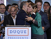 BOGOTA - COLOMBIA, 17-06-2018: Ivan Duque, presidente electo y candidato presidencial por el partido Centro Democrático, besa a su vicepresidente, Martha Lucia Ramirez, durante su alocución al finalizar la segunda vuelta de las elecciones presidenciales de Colombia 2018 hoy domingo 17 de junio de 2018. El candidato ganador gobernará por un periodo máximo de 4 años fijado entre el 7 de agosto de 2018 y el 7 de agosto de 2022. / Ivan Duque, elected president and presidential candidate for the Centro Democratico party, kisses his vice president, Martha Lucia Ramirez, during his speech after Colombia's second round of 2018 presidential election today Sunday, June 17, 2018. The winning candidate will govern for a maximum period of 4 years fixed between August 7, 2018 and August 7, 2022. Photo: VizzorImage / Gabriel Aponte / Staff