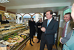 David Cameron, the Conservative Party leader rubs his hands together as he decides what to buy for lunch at the Myrddin Bakery in Carmarthen as he toured the area and spoke to local businesses during his visit to South Wales today..The Conservatives want to introduce a bill demanding compulsory country of origin labelling, which will require products carrying the UK flag to be born, reared and processed in Britain...