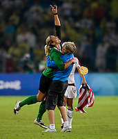 USWNT head coach Pia Sundhage celebrates the win with goalkeeper Hope Solo after playing for the gold medal at Workers' Stadium.  The USWNT defeated Brazil, 1-0, during the 2008 Beijing Olympic final in Beijing, China.