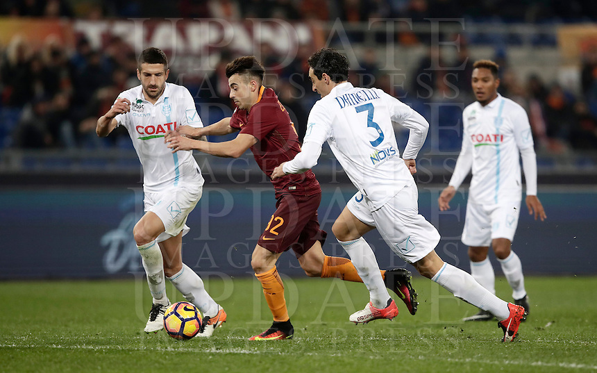 Calcio, Serie A: Roma vs ChievoVerona. Roma, stadio Olimpico, 22 settembre 2016.<br /> Roma's Stephan El Shaarawy, center, is challenged by Chievo Verona's Alessandro Gamberini, left, and Dario Dainelli, during the Italian Serie A football match between Roma and Chievo Verona, at Rome's Olympic stadium, 22 December 2016.<br /> UPDATE IMAGES PRESS/Isabella Bonotto