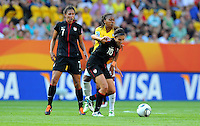 Shannon Boxx (l) and Carli Lloyd of team USA and Ester of team Brazil during the FIFA Women's World Cup at the FIFA Stadium in Dresden, Germany on July 10th, 2011.