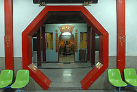Octagonal doorway inside a temple in Taitung City, Taiwan. Taitung, and the coastal strip north of it up to Chenggong, has been seeing a big increase in property investment and new construction as people from the capital, Taipei, and some foreign investors, seek to buy holiday and retirement homes in this area of outstanding natural beauty. At the same time, property prices across the board in Taiwan are expected to rise bullishly following a return of the former ruling party - the KMT - to power in March 2008 elections, and their anticipated change of policy to allow Mainland Chinese purchases of Taiwan property.  .20 Jan 2008