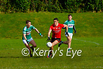 David Clifford Fossa goes past Ronan Buckley Listry during their Junior Championship clash in Fossa on Sunday