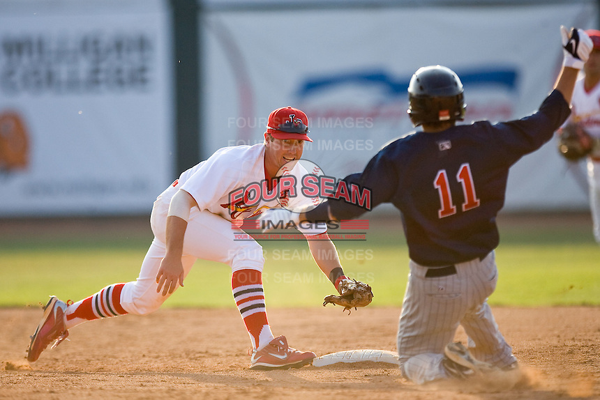 Packy Elkins #9 of the Johnson City Cardinals gets ready to apply the tag on Gunner Glad #11 of the Elizabethton Twins at Howard Johnson Field July 3, 2010, in Johnson City, Tennessee.  Photo by Brian Westerholt / Four Seam Images