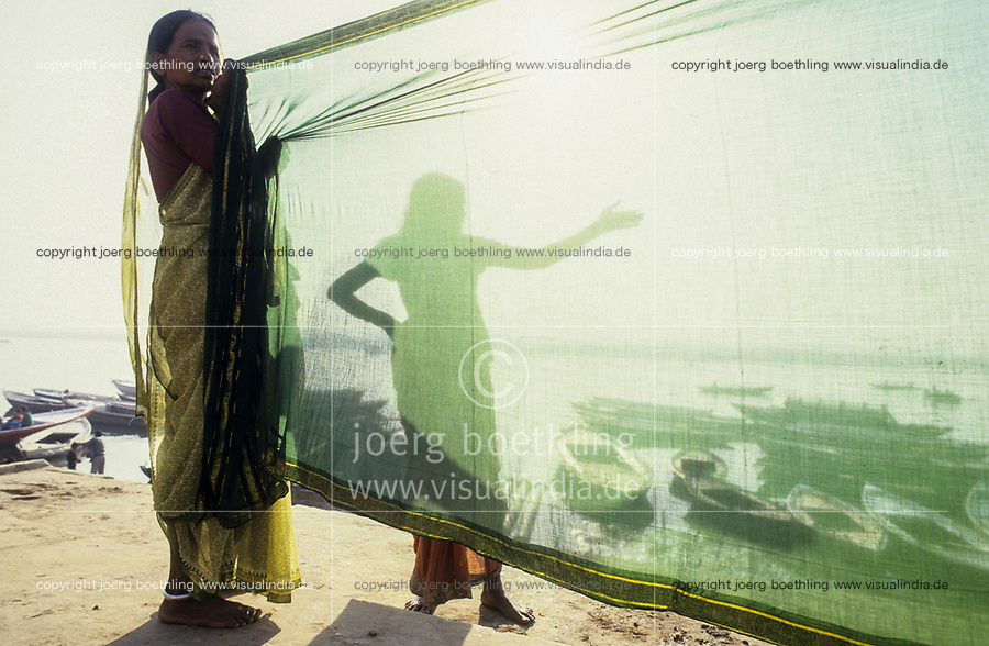 INDIA, Uttar Pradesh, Varanasi, river Ganges seen through green Sari, the old Banaras or Kashi or ANANDAVANA ( forest of bliss ) is a sacred place for Hindus to achieve Moksha meaning salvation from eternal circle of rebirth, the Ganga river is a crossing place from earth to heaven, women dry Sari after a holy dip in the river