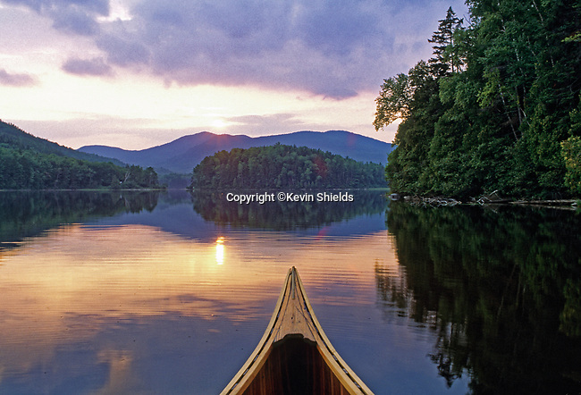 Canoe on Lower Pond, Chain of Ponds, Maine, USA. This waterway was used by Benedict Arnold's army en route to Quebec in 1775-76 in an unsuccessful attempt to defeat the British there.