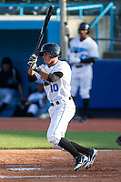 Douglas Duran (10) of the Hudson Valley Renegades follows through on his swing against the Brooklyn Cyclones at Dutchess Stadium on June 18, 2014 in Wappingers Falls, New York.  The Cyclones defeated the Renegades 4-3 in 10 innings.  (Brian Westerholt/Four Seam Images)
