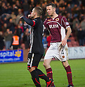 Stenny's Eddie Malone is unhappy at the role Pars' Ryan Wallace played in the penalty award as he celebrates scoring their second goal from the spot.