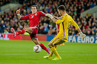 Wednesday 4th  December 2013 Pictured: ( l-r ) Gareth Bale of Wales charges down Tasos Kissas of Cyprus <br /> Re: UEFA European Championship Wales v Cyprus at the Cardiff City Stadium, Cardiff, Wales, UK