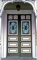 Ferndale CA:  831 Main St.--door and porch balustrades.   Photo '83.